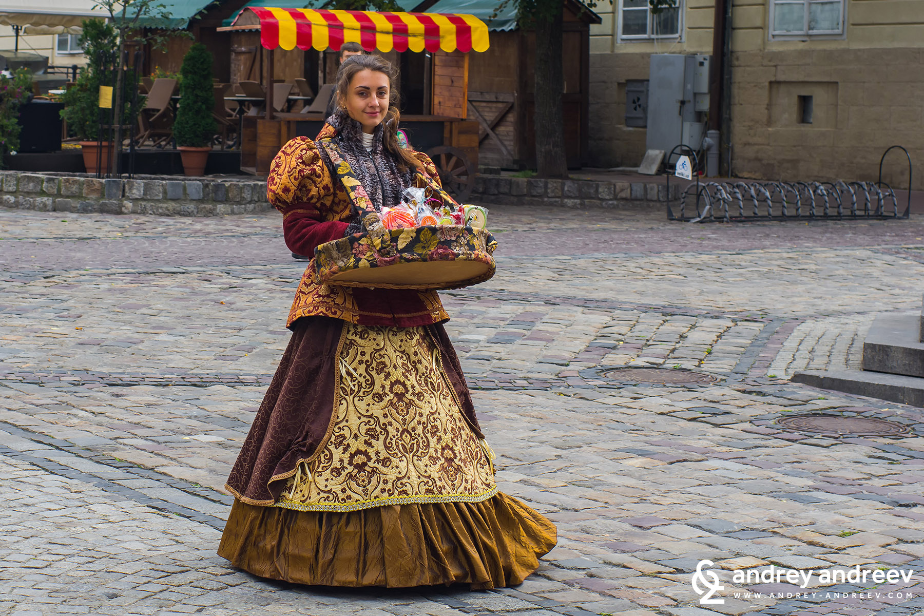 Girl from Lviv selling souvenirs to tourists