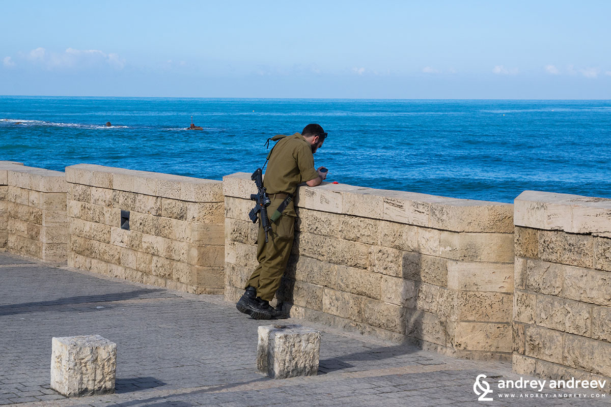 Soldier guarding the promenade in Tel Aviv Israel