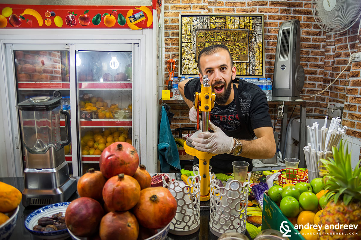 A nice guy making pomegranate juice in Jerusalem