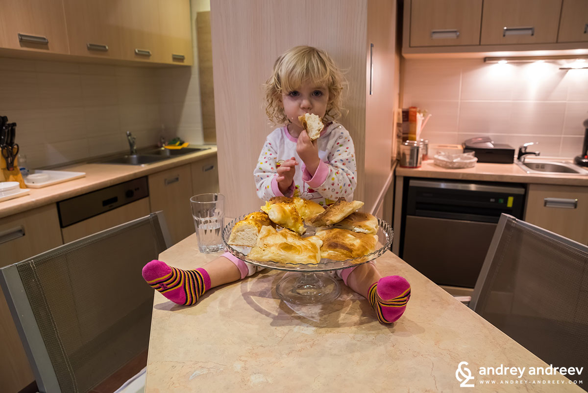 My daughter Anna eating Banitsa - Bulgarian food