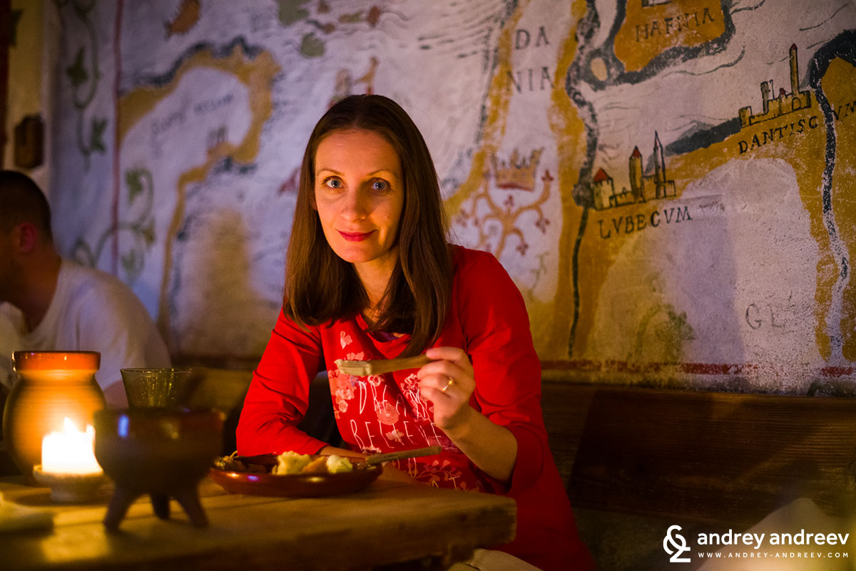 Maria eating medieval dinner at Olde Hansa