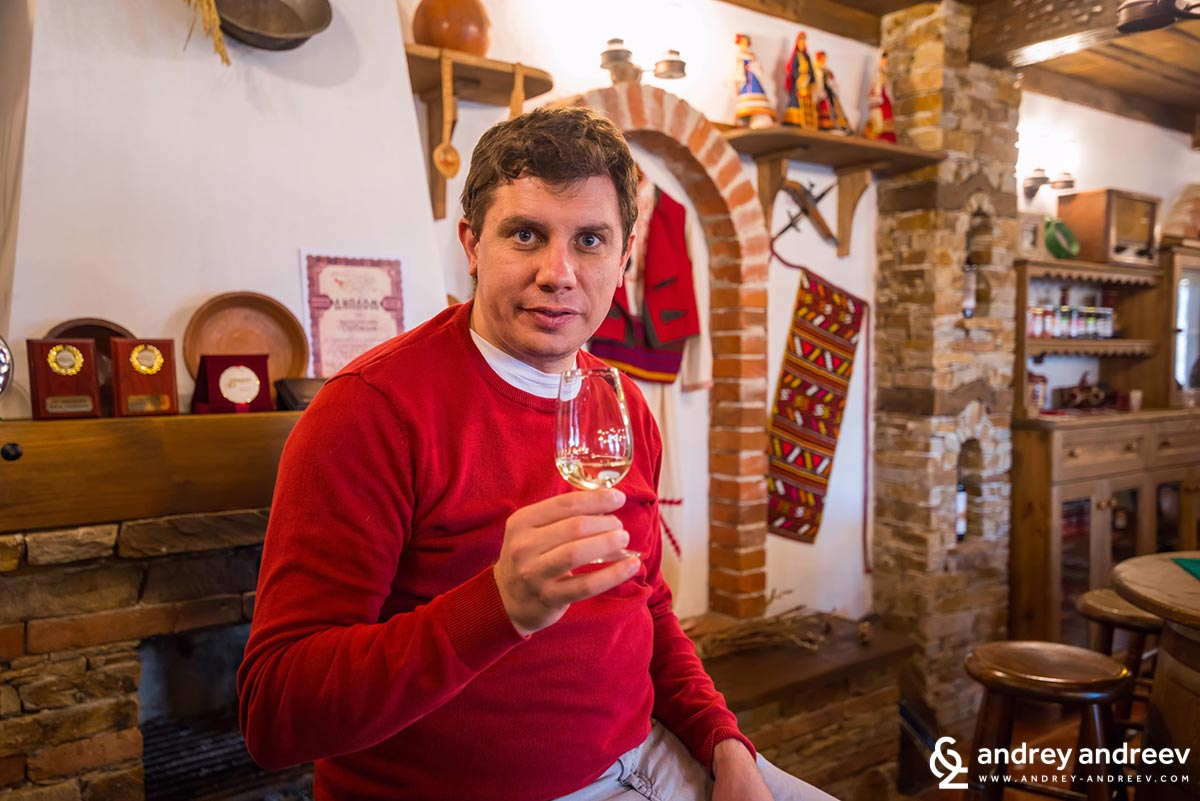 Andrey tastes wine at Orbelia winery
