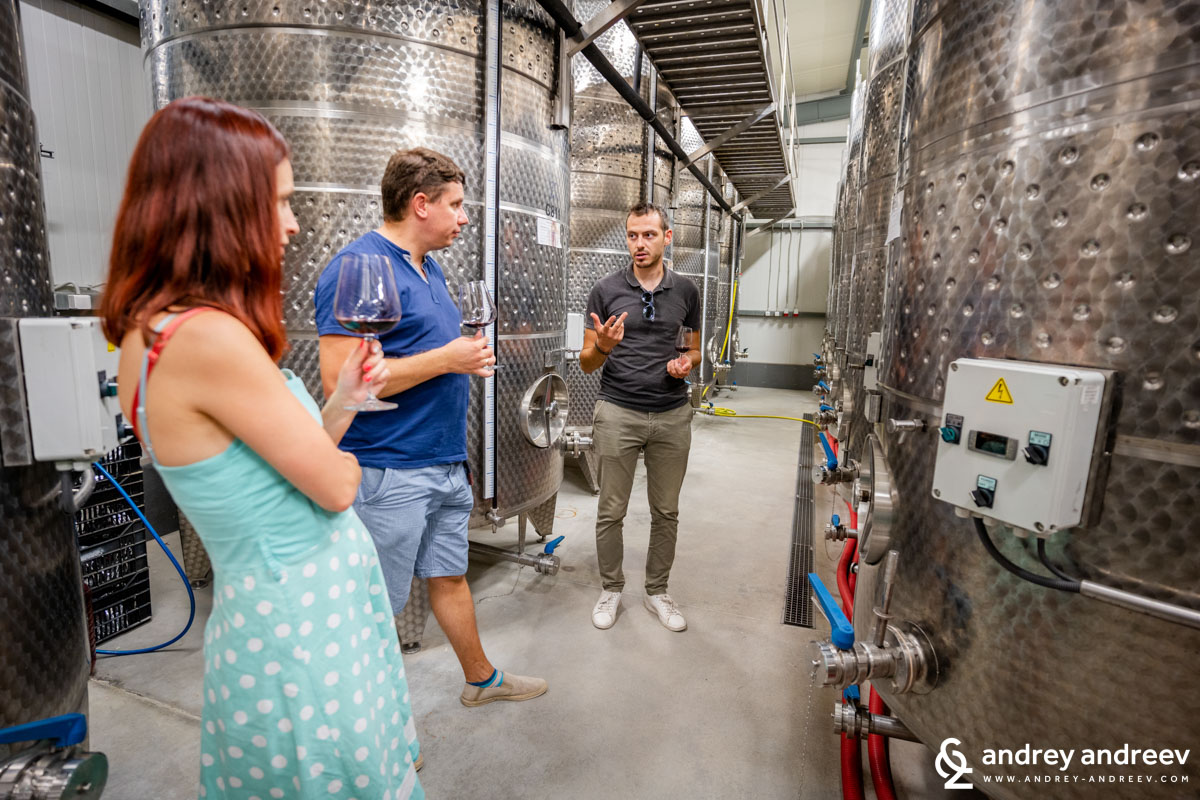 Tasting wine from the tank with the new winemaker Kiril