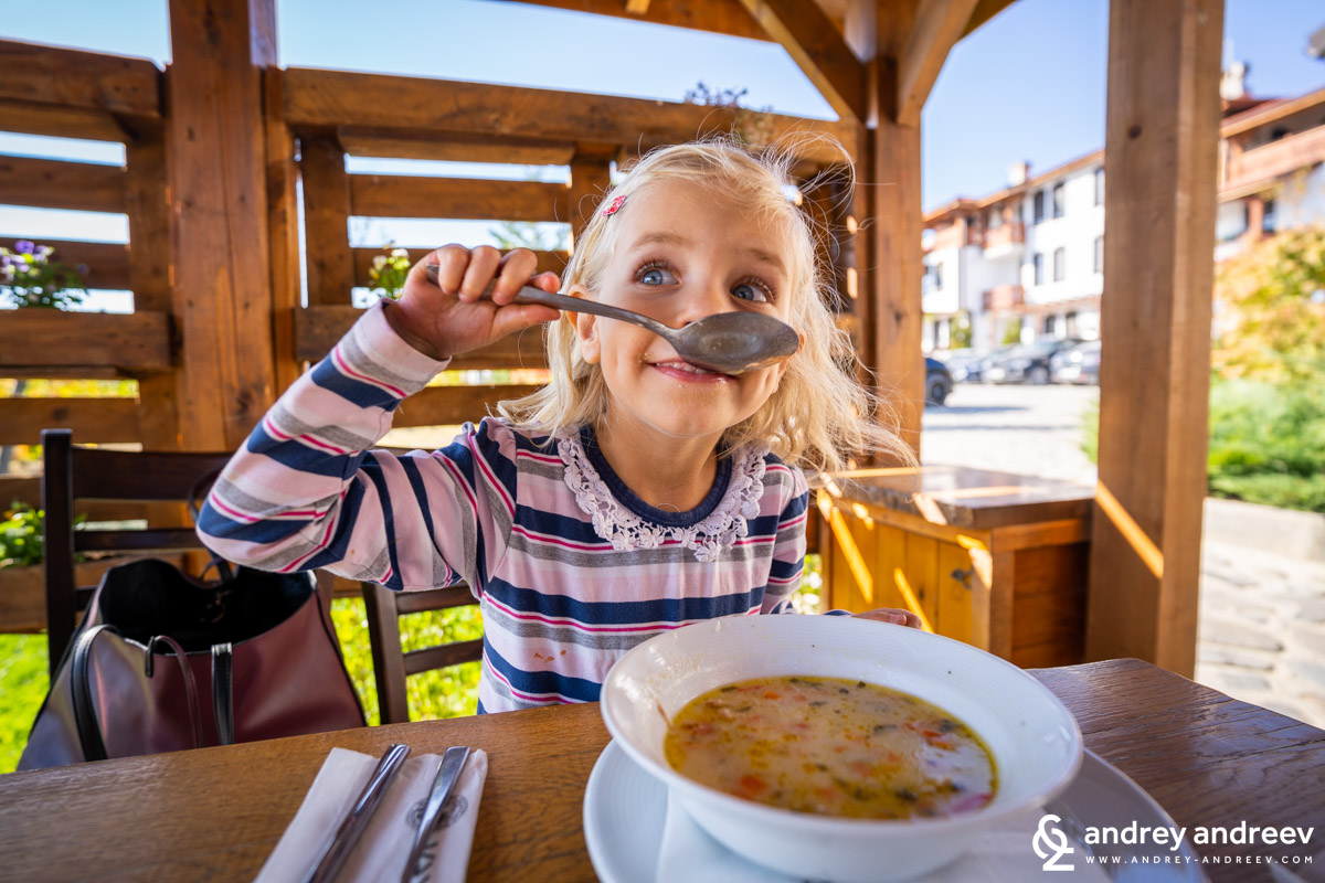 Anna eating soup in one of the restaurants in Starosel