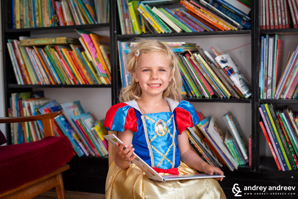 Anna dressed like Snow White, reading books in the Fairy Tale museum in Nicosia