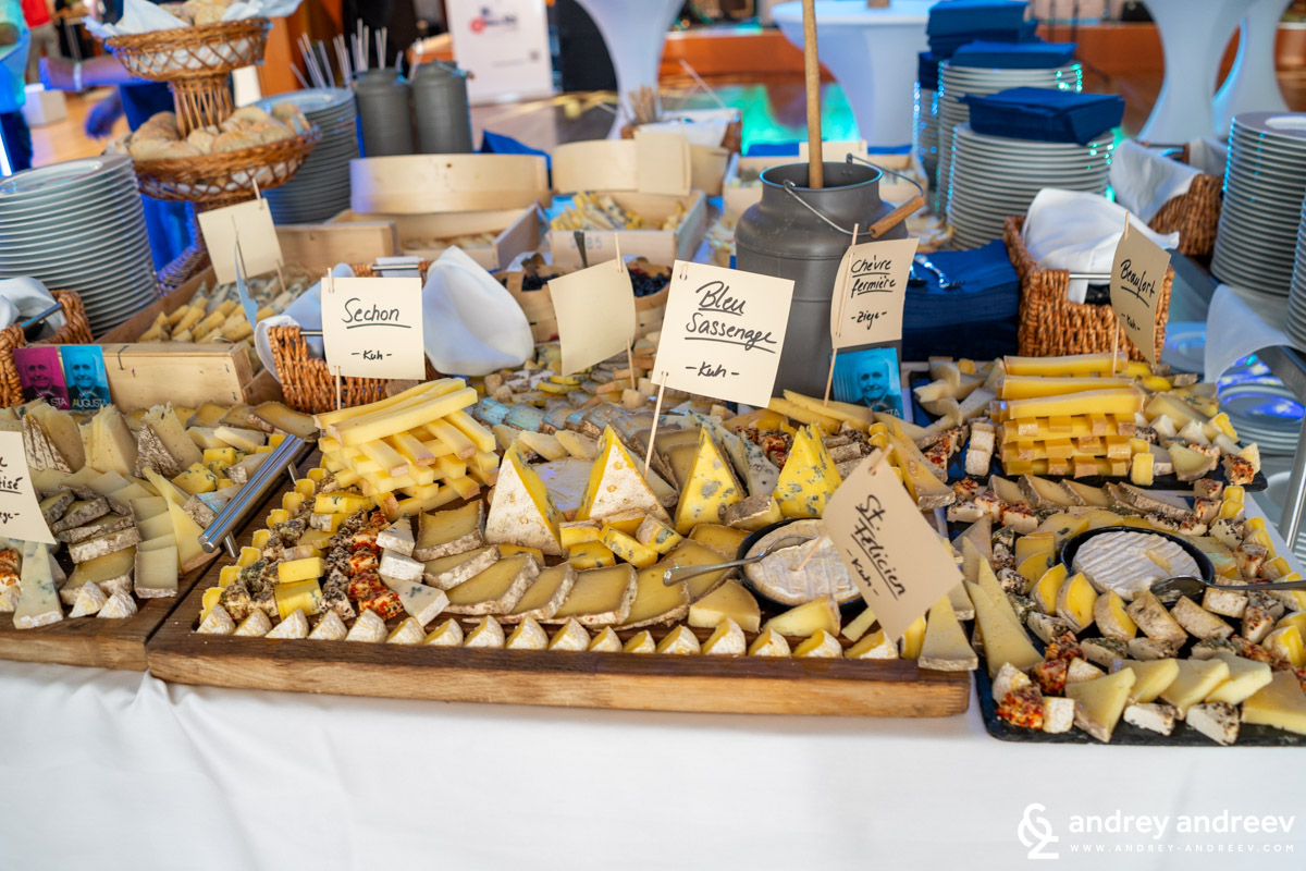 The table with various delicious cheeses, which appeared to be mostly French