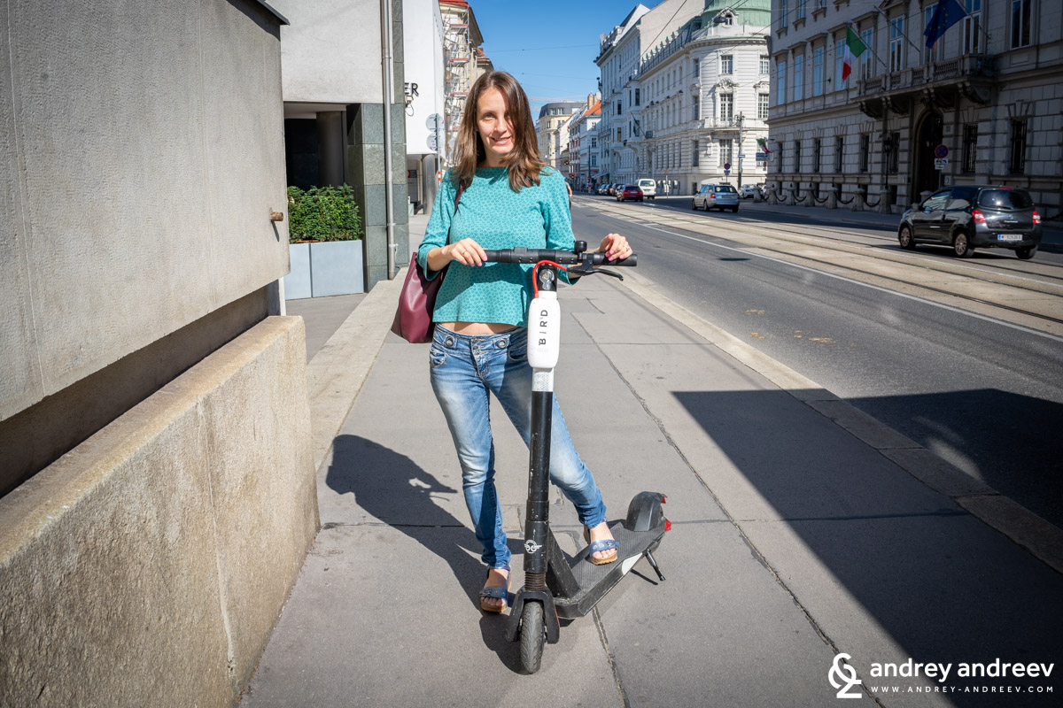 Maria trying to ride an electric scooter in Vienna