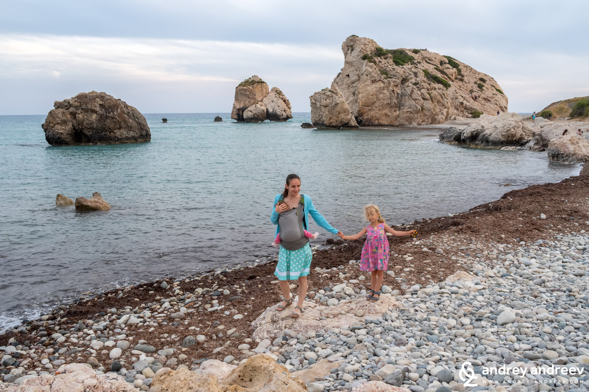 My girls walking on the pebbly Beach of Aphrodite in Cyprus