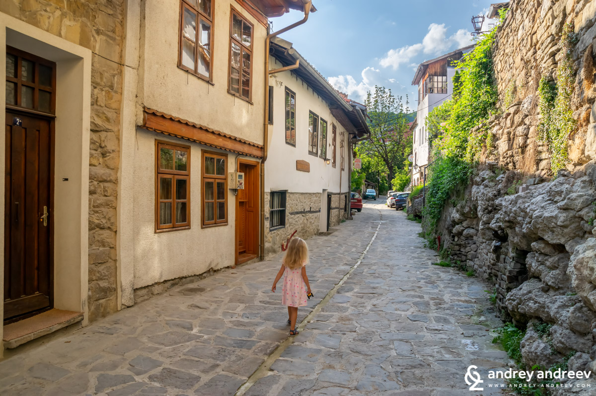 Little Anna running along General Gurko street in Veliko Tarnovo, Bulgaria