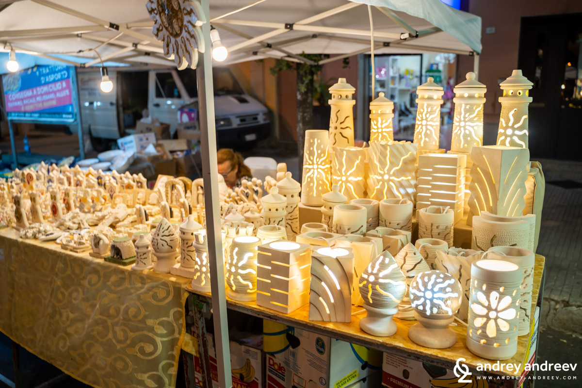 A stall with ceramic lamps during La Cappeddha market in Taviano