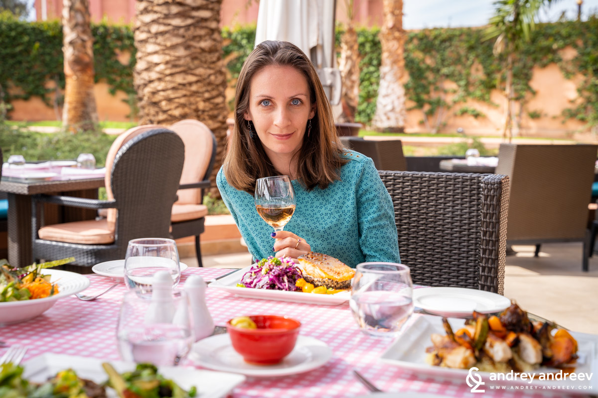 Maria looking happy when she pairs her meal with a glass of wine