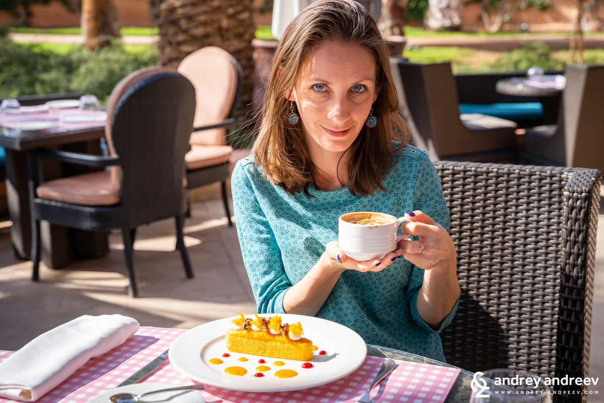 Maria showing love to her coffee and dessert - Jamra restaurant, Movenpick Marrakech