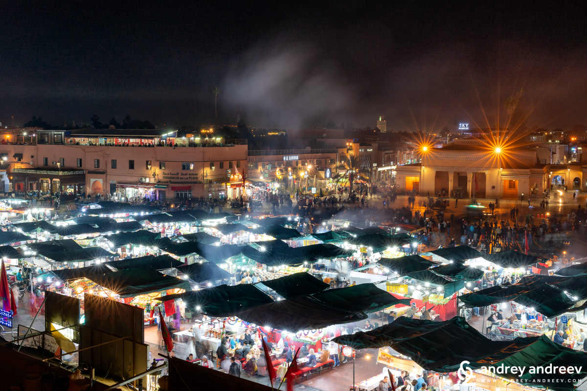 Tens of tables with food on Jemaa El-Fnaa square in Marrakech Morocco