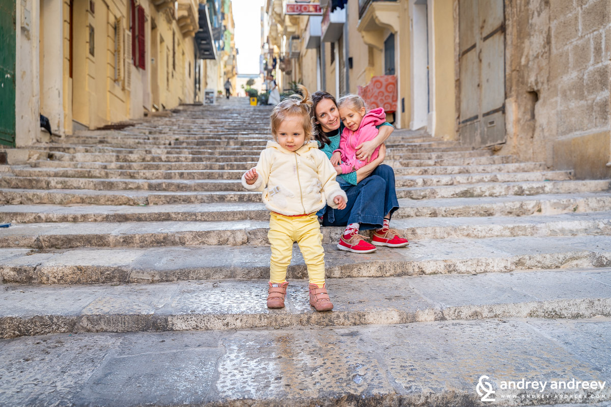 Maria and the kids on the stairs of Valletta, Malta
