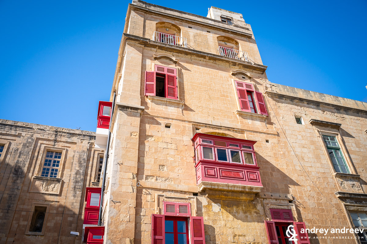 The charming balconies of the building in Valletta, Malta
