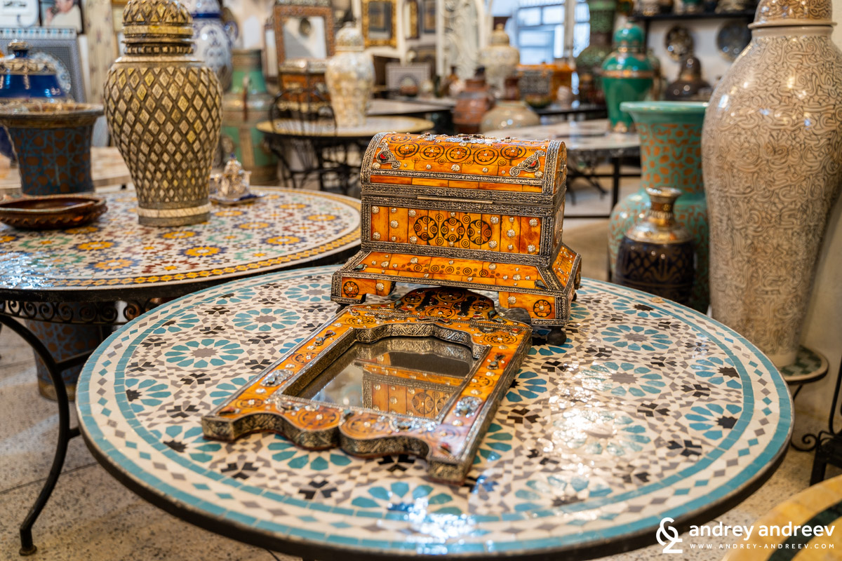 The typical Moroccan tables, heavy and with ceramic mosaics