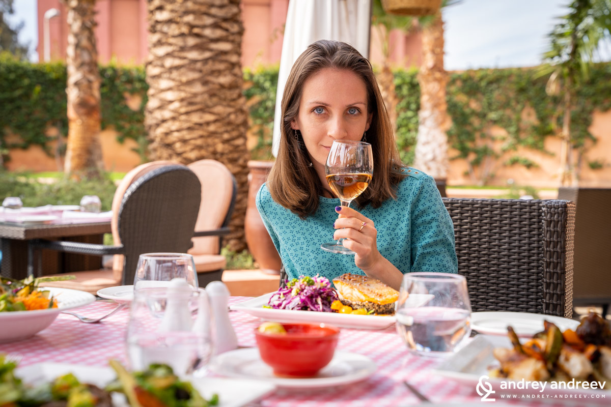 Maria enjoys a glass of wine in a nice restaurant in Marrakech