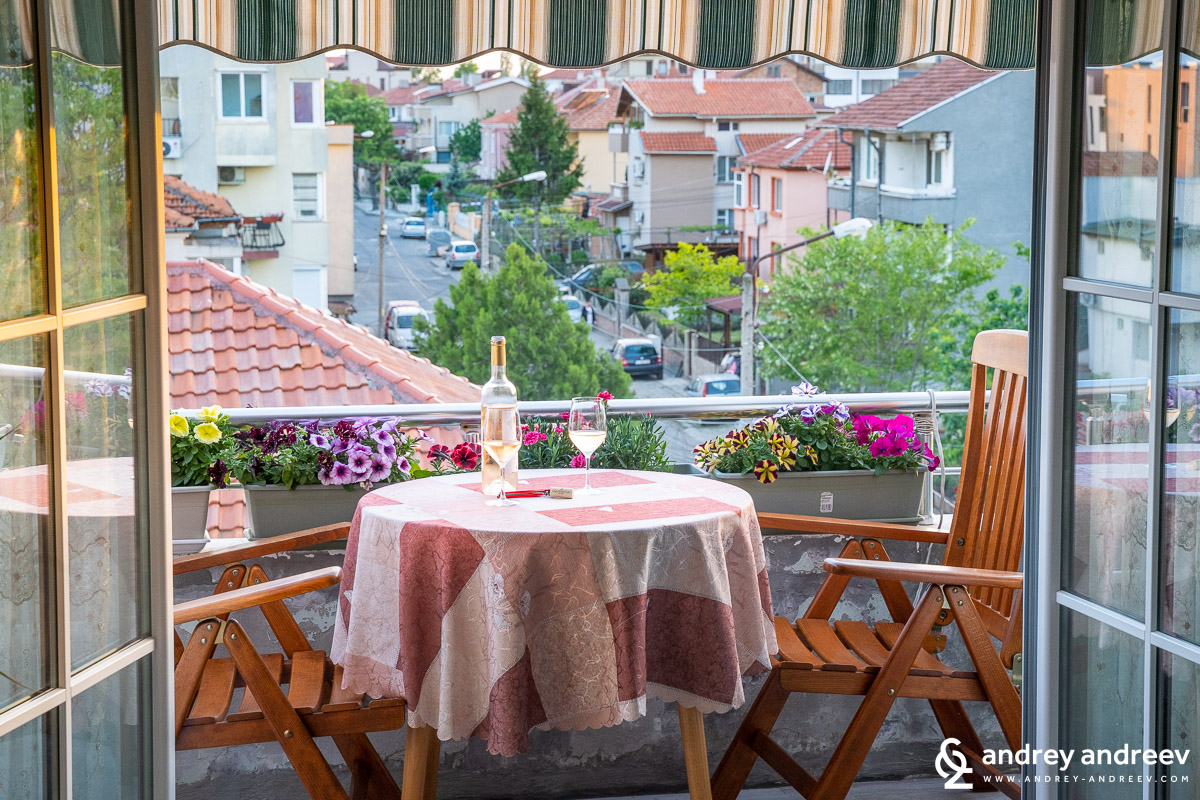 Summer idilly with wine on the balcony