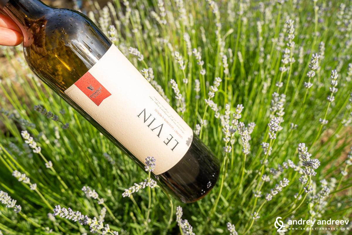 The bottle of LE VIN Cabernet Sauvignon & Merlot among our lavender flowers