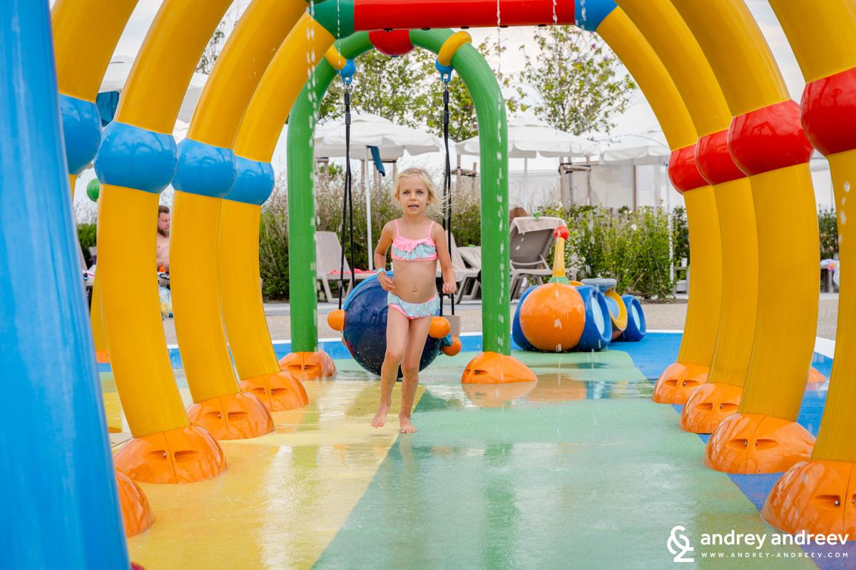 Anna running on the water playground