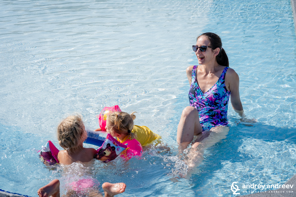 Maria and the kids having fun in the pool